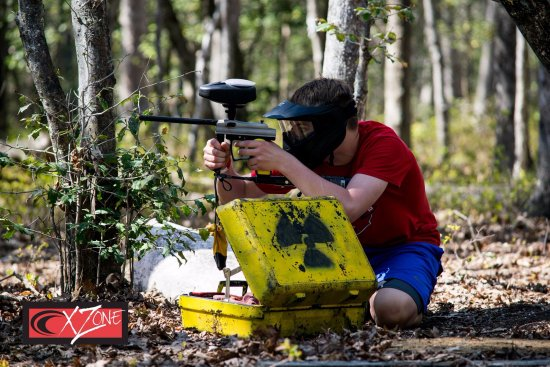 Chesterfield, VA: Teen playing low-impact paintball while defending a prop in an objective based game.