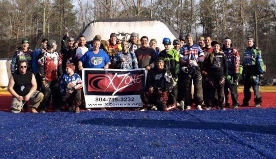 Chesterfield, VA: Competition paintball players posing for a picture with professional player Kyle Spicka.