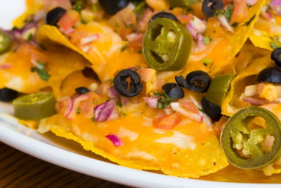 West Orange, NJ: House-made Tortilla Chips smothered in Cheese with jalapenos, olives, Salsa, add Chili as an opt