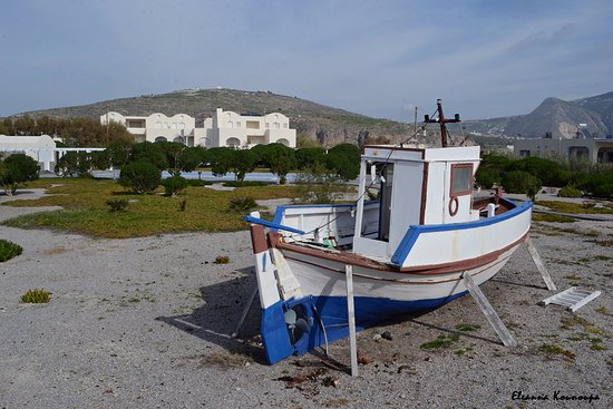 Emporio, Greece: A boat decorate the exterior of the hotel