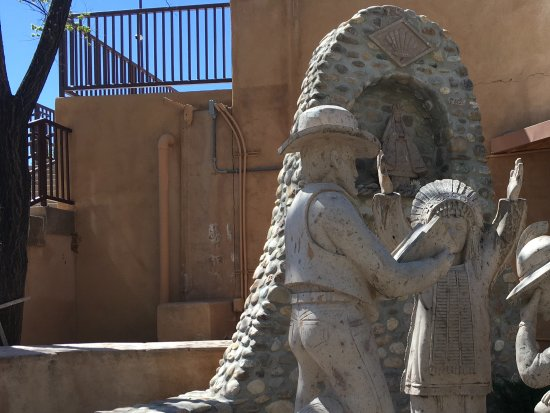 Ranchos De Taos, NM: Statue showing the white man, Indian and Hispanic worshing together at Chimayo