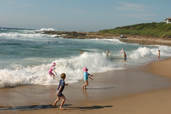 Umzumbe, South Africa: Kids playing in the sea