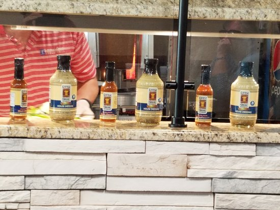 Little Greek Fresh Grill: Anumber of Greek condiments for sale
