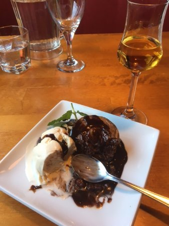 Kokkola, Finland: Rosso's nutty chocolate cake, served with chocolate sauce and vanilla ice cream.