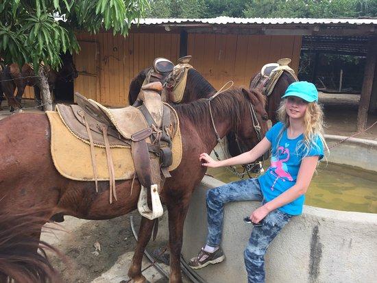 St. Paul,MN girl and family ready to ride along Playa Larga.