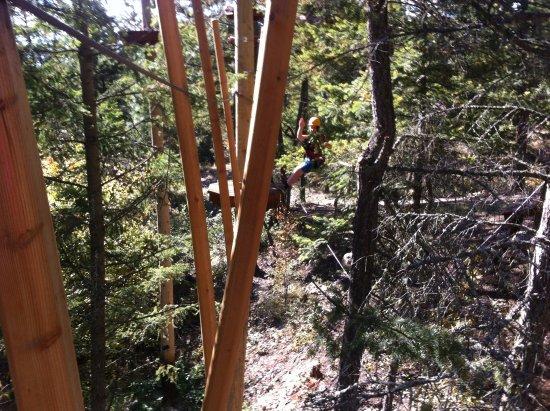 Oyama, Canada: Tightrope walk around the poles while harnesses