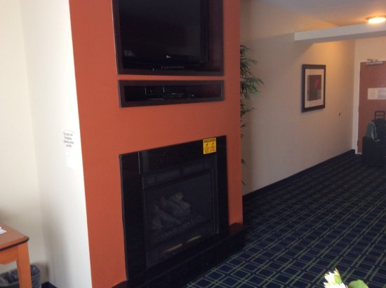 Kearney, NE: Large screen television above fireplace