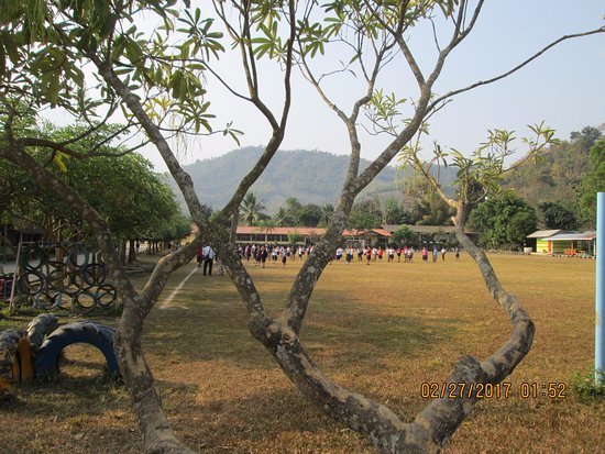 Maekok River Village Resort: student field behind the resort