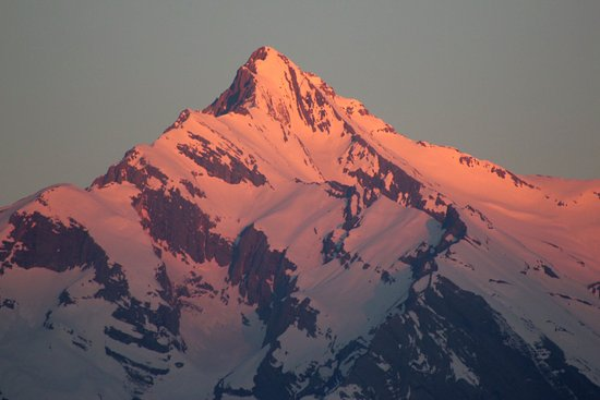 Vex, Swiss: view of sunrise over the Haut de Cry from Bellevie
