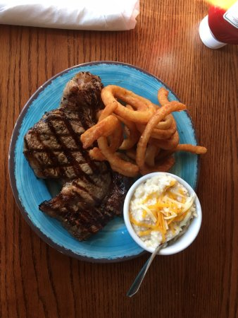 Madison Chop House Grille: Steak, onion rings and cheese grits