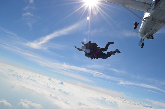 Skydive Carolina!: beautiful exit against our Carolina sky