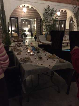 Ksar Anika: Our table set with rose petals for dinner by the pool.