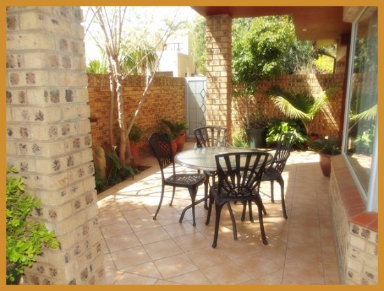 Centurion, South Africa: Covered porch exclusive to Room 210 where guests can sit and relax. Has WiFi access in this area