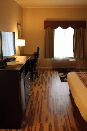 Clive, IA: Executive king room with hardwood floor.