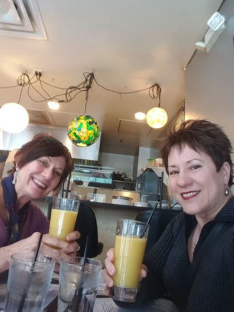 Enjoying peach mimosas at the Dime Store in Detroit