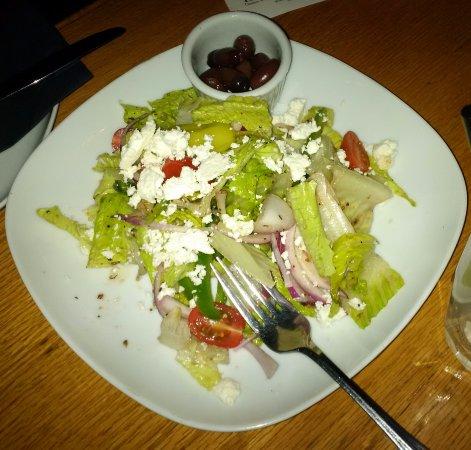 Cassios Italian Restaurant: Italian salad-tomatoes, red onions, peppers, feta, kalamata olives and vinaigrette dressing