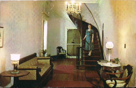 Greensboro, AL: Margaret Hobson on stairs in the Hall of Magnolia Grove