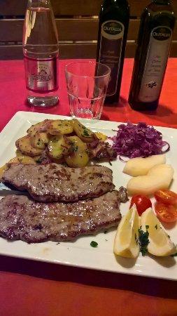 L'Usignolo: Bistecca con patate saltate...