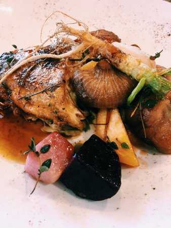 Pasture raised chicken with organic hay, seasonal vegetables and roots
