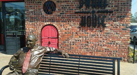 Hapeville, GA: Statue of Truitt Cathy, founder of Chick-Fil-A, with original Dwarf Door behind him
