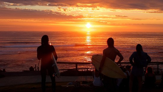 Prevelly, Australia: Surfers gather to watch the setting sun