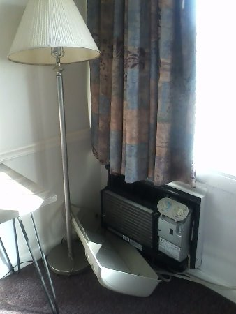 Waterford, CT: air conditioner cover off the wall, dirty shade on lamp