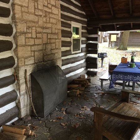 Sigel, Pensilvania: Porch area of cabin 13--restrooms are in the building in the background, behind the tree.