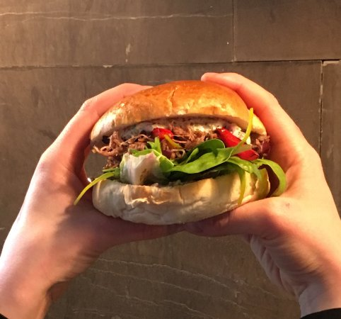 Hungry Dane: Signature Confit, caramelized brioche, fresh crispy salad, grilled red Piquillo peppers