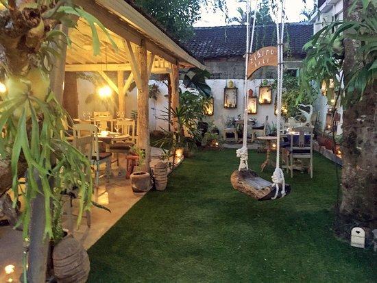 Zibiru: Al fresco dining in our tropical garden