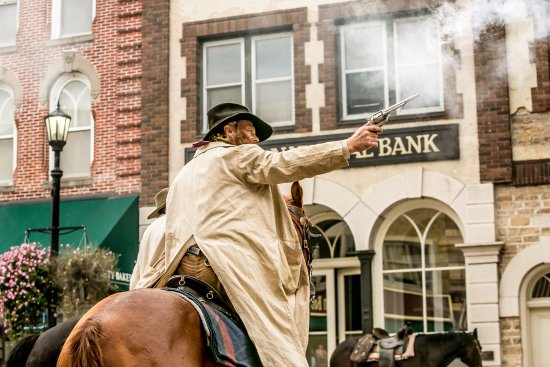 Actor re-enacting the James-Younger raid on the First National Bank Northfield