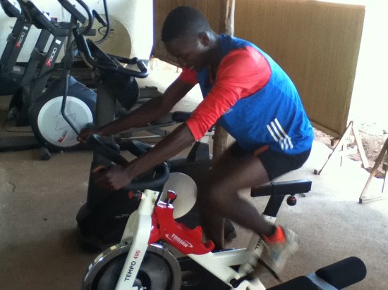 Gulu, Uganda: Ronald Tonny onono, the gym instructor, working out at the fitness section of the center