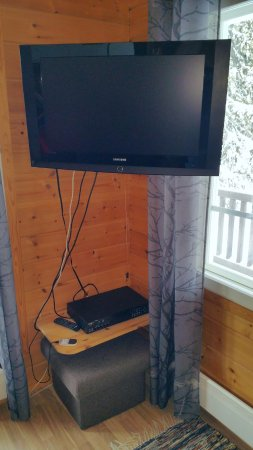 TV with set-top box and wifi router - Picture of Napapiirin