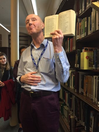Linen Hall Library: Gerry, the tour guide, explaining about how people who owned bicycles were cataloged.