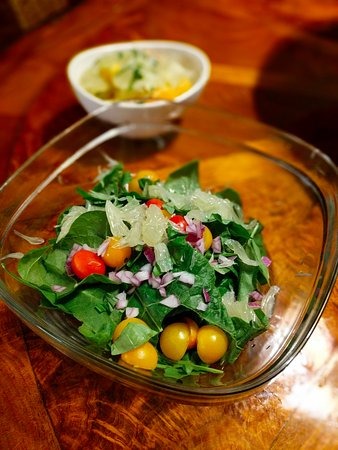Holualoa, HI: Salads prepared from pomelos, oranges, tomatoes, basil, arugula and kale all found on the proper