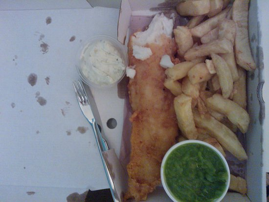 Tonyrefail, UK: Fish supper meal (comes with the mushy peas and tartar sauce)