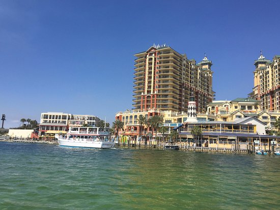 Emerald Grande at HarborWalk Village: The view of the resort from the boat to the private beach.