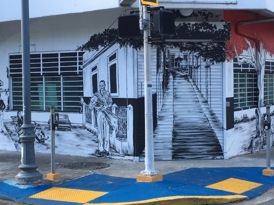Hotel & Hostel San Jorge: Mural outside Hotel San Jorge by local artist Sarah Urbain depicts traditional street scenes.