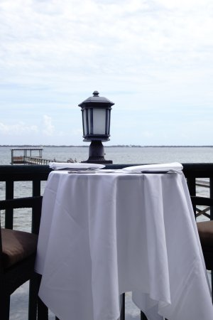 Malabar, FL: Veranda table with waterside view.
