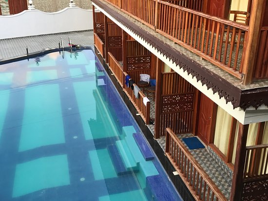 Swimming pool view ground floor rooms are attached with pool ...