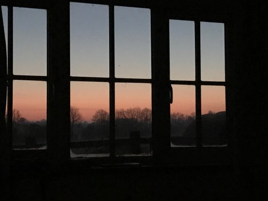 Stanwick, UK: Morning breaking at Redlands Farm