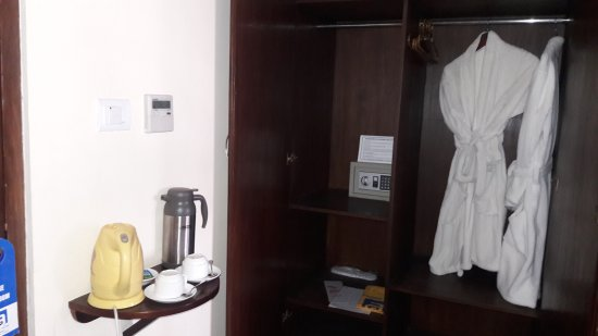 Summit Residency: Wardrobe with bath robe, safe,in house slippers and tea coffee maker