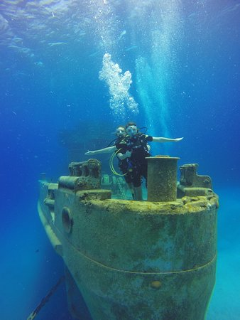 "Kittiwake Shipwreck & Artificial Reef: My daughters doing their Titanic ""Jack and Rose"" pose at the USS Kittiwake"