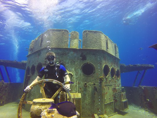 Kittiwake Shipwreck & Artificial Reef: My son taking the obligatory USS Kittiwake pic!