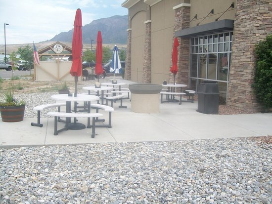 North Ogden, UT : Outdoor seating area at Lost Texan w/smokehouse in background