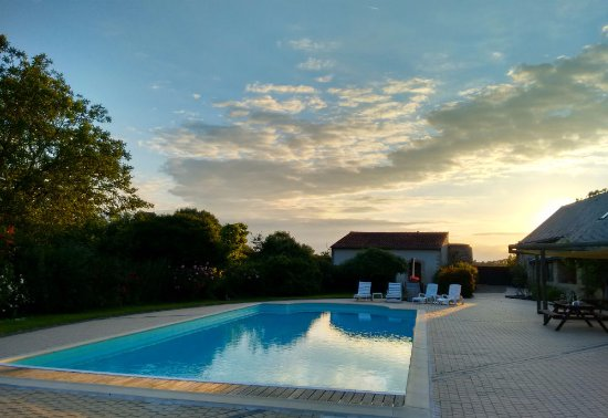 Faye-d'Anjou, France : Looking west at sunset by the pool