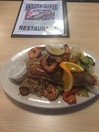 Angleton, TX: Grilled Red Snapper with shrimp and scallops with Dirty rice and steamed veggies.