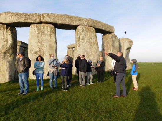 International Friends: Our guide David explaining Stonehenge history