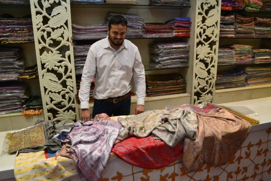 The owner showing silk scarfs