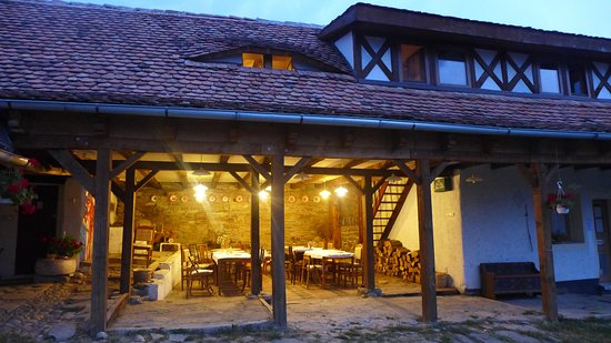 Viscri 44: The outdoor dining area in the evening.
