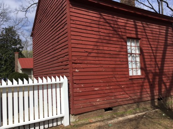 Franklin, TN: Wooden building damaged by gunfire. You can see a little of the Carter House behind.